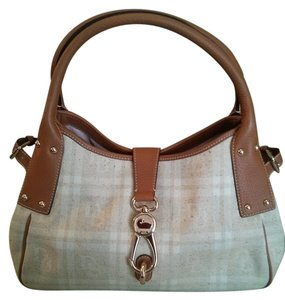 Dooney & Bourke Satchel in tan trimmed in light brown leather