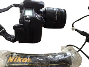 Nikon Nikon D200 with 24-120mm lens, attachable professional flash, Lowepro camera bag