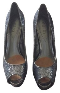 Guess Silver sequin shoe with a pewter heel Platforms