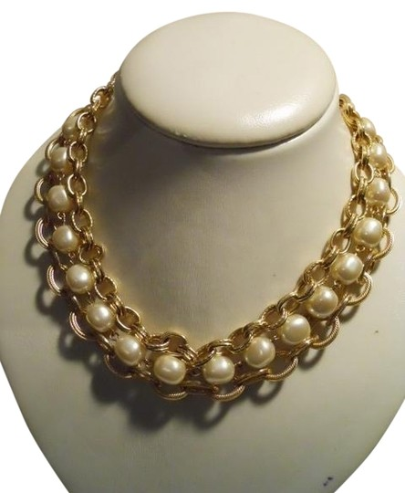 Preload https://item5.tradesy.com/images/gold-tone-faux-pearl-triple-chain-necklace-1086874-0-0.jpg?width=440&height=440