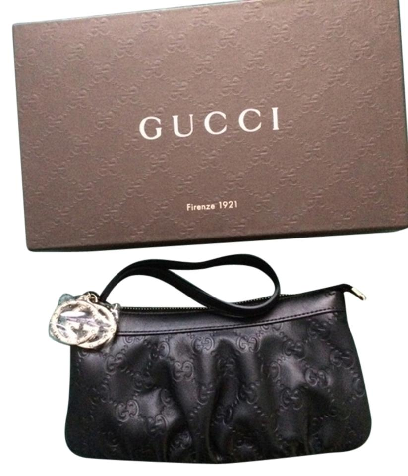 d388ea77d58 Gucci Guccissima Leather Interlocking G Wrist Wallet Clutch 212203 Wristlet  in Black Image 0