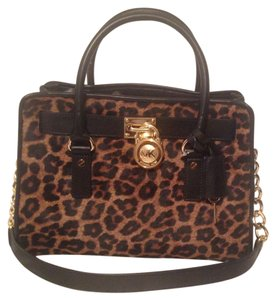 Michael Kors Satchel in Black Leather With Cheeta Haircalf Leather On Front