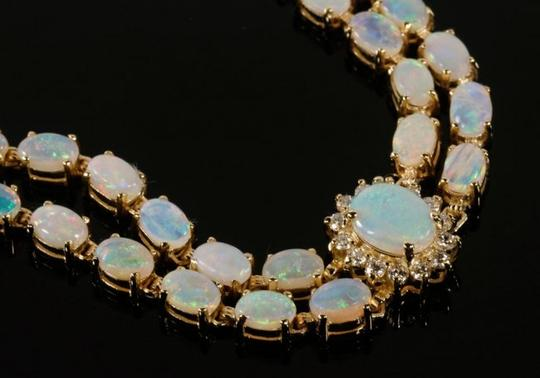 Preload https://img-static.tradesy.com/item/10915705/white-opal-14kyg-and-diamond-with-locking-clasps-bracelet-0-2-540-540.jpg