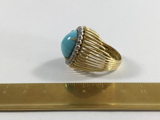 Other Turquoise Ring in Gold with a Halo of Diamonds