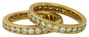 Tiffany & Co. A Pair of Tiffany Diamond Gold Eternity Bands