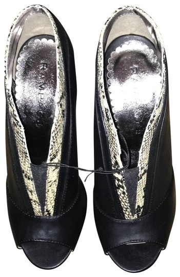 Preload https://item4.tradesy.com/images/rampage-black-with-python-trim-ankle-bootsbooties-size-us-8-regular-m-b-109443-0-0.jpg?width=440&height=440