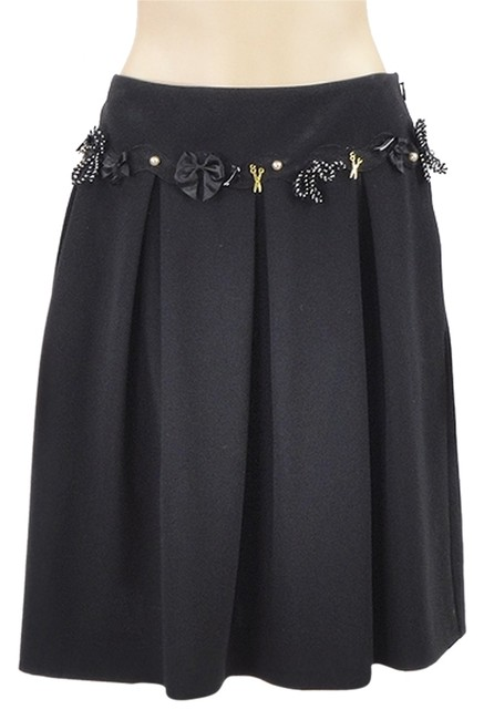 Preload https://item1.tradesy.com/images/moschino-black-triacetate-pleated-with-charms-knee-length-skirt-size-8-m-29-30-1099855-0-0.jpg?width=400&height=650