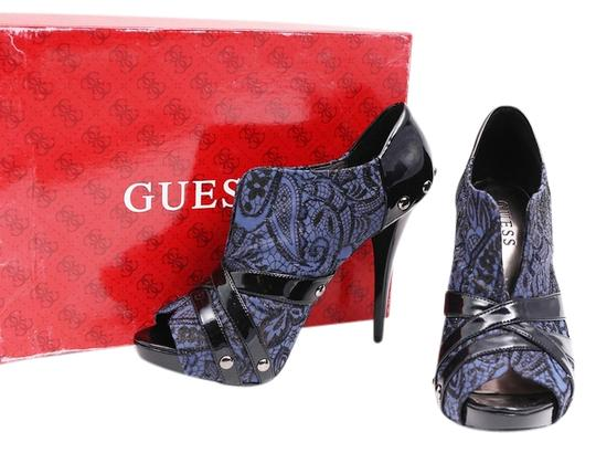 Preload https://img-static.tradesy.com/item/11020597/guess-blueblack-gwentire-ankle-lace-bootsbooties-size-us-85-regular-m-b-0-1-540-540.jpg