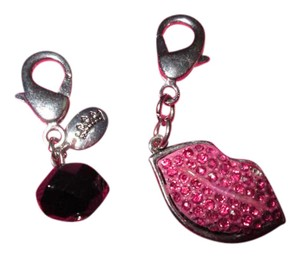 Juicy Couture Juice Couture Dark pink lips. Free black cut charm.So Cute! NWOT