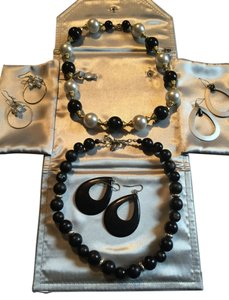 A double duo deal. Two beaded necklaces with three pair of mix and match earrings.
