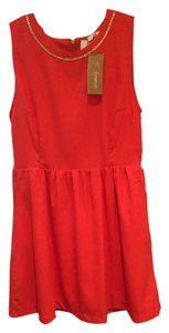 Emmelee short dress Orange with Gold detail on Tradesy