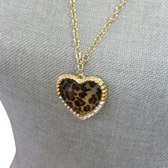 Preload https://item3.tradesy.com/images/gold-and-animal-print-long-necklace-1110547-0-0.jpg?width=440&height=440