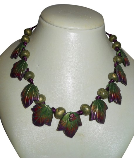 Preload https://img-static.tradesy.com/item/11137507/green-and-purple-ceramic-leaf-corded-necklace-0-1-540-540.jpg