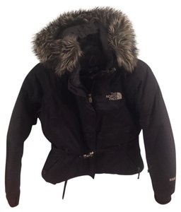The North Face Northface with a buckle and zipper closer