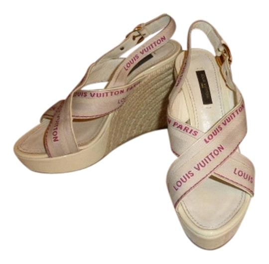 Preload https://img-static.tradesy.com/item/11157403/louis-vuitton-off-white-patent-leather-fabric-strap-9-long-wedges-size-us-6-regular-m-b-0-2-540-540.jpg