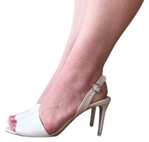 Prada Cream Pumps