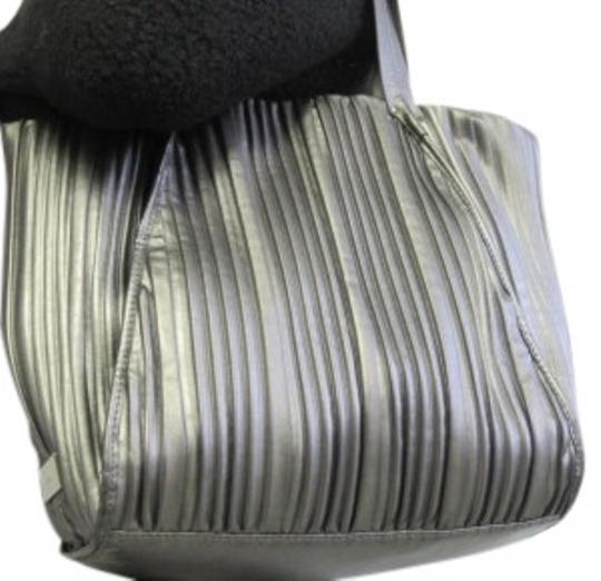 Preload https://item5.tradesy.com/images/calvin-klein-silver-large-pleated-silver-metallic-leather-tote-11204-0-0.jpg?width=440&height=440