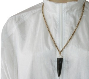 Roberto Cavalli Authentic Roberto Cavalli shark tooth necklace, in excellent condition