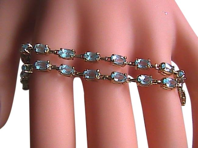 Yellow Gold Blue Topaz 10k Solid Bracelet Yellow Gold Blue Topaz 10k Solid Bracelet Image 1