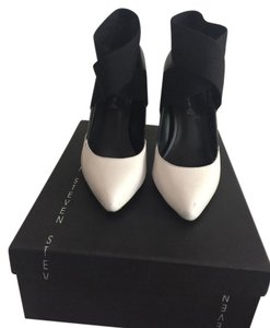 Steve Madden Black and White Pumps