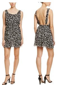 BCBGeneration short dress Black Floral Open Back Fully Lined Mini on Tradesy
