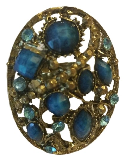 Other Fashion ring in gold with turquoise and royal blue color stones