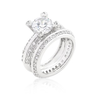 A. A. A. Cz Round Cut Clear Solitary Stone Atop Pave Setting Wedding Ring Set