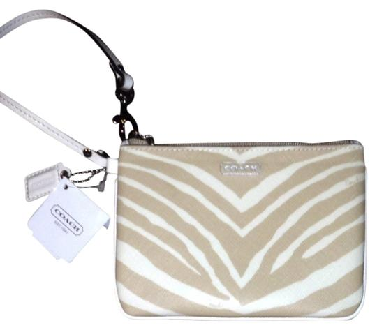 Preload https://img-static.tradesy.com/item/1130502/coach-zebra-tan-light-khaki-wristlet-0-0-540-540.jpg