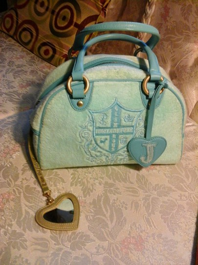 Juicy Couture Angel Has Sequence On The Letters Zipper Pull Has Written On It The Inside Pockets Has Shop & Hello Written On It. Satchel in Blue
