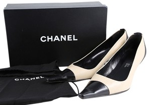 Chanel Leather Pointy Toe Kitten Heels Tan/Black Pumps