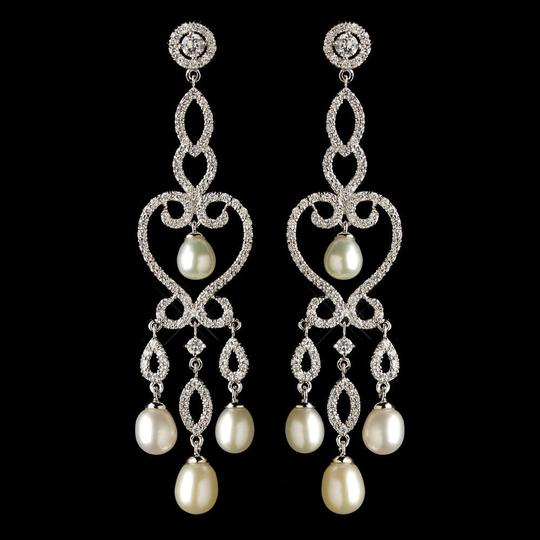 Preload https://img-static.tradesy.com/item/1135820/elegance-by-carbonneau-silverlight-ivory-cz-and-freshwater-pearl-earrings-0-0-540-540.jpg