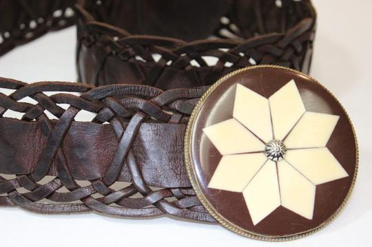 Preload https://item4.tradesy.com/images/brown-rare-moroccan-leather-woven-wide-belt-1136978-0-0.jpg?width=440&height=440