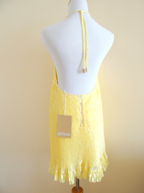 John Galliano Lovely And White Pleated Design Halter Neckline Open Back Decorative Ruffle On Hemline. Add A Cute Girly Vibe To Your Tunic