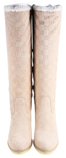 Preload https://img-static.tradesy.com/item/11375983/gucci-beige-guccissima-suede-and-shearling-bootsbooties-size-us-95-regular-m-b-0-1-540-540.jpg