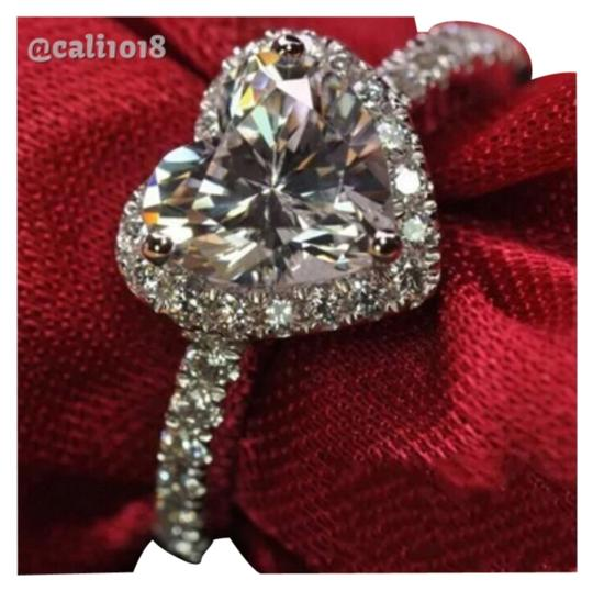 Preload https://img-static.tradesy.com/item/11380105/silver-1ct-center-heart-shaped-stone-with-cz-accents-925-ring-0-1-540-540.jpg