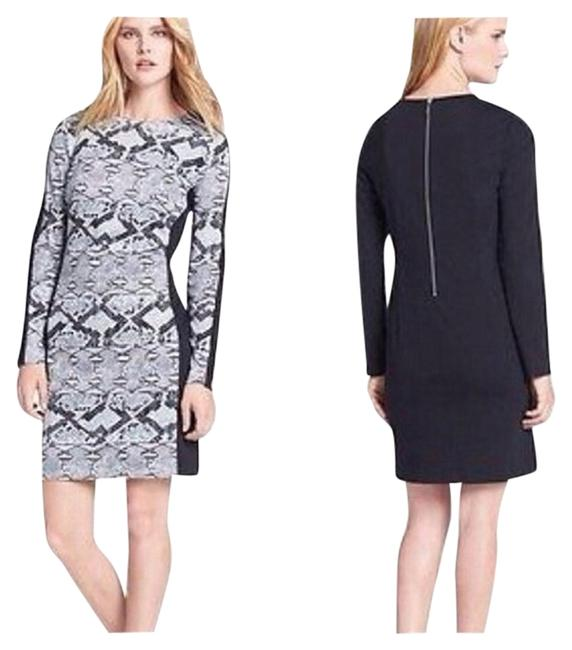 Preload https://item1.tradesy.com/images/michael-kors-animal-print-colorblocked-above-knee-workoffice-dress-size-0-xs-1138105-0-0.jpg?width=400&height=650