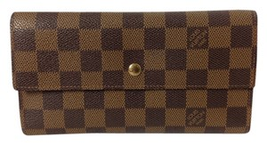 Louis Vuitton Authentic Louis Vuitton Damier Ebene Tri-Fold Long Wallet.