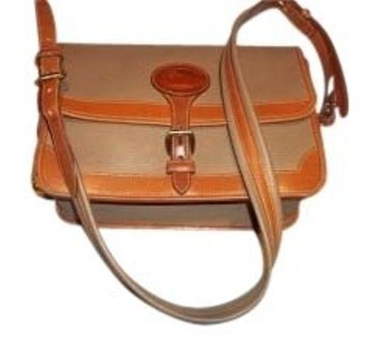 Preload https://item1.tradesy.com/images/dooney-and-bourke-adjustable-strap-taupe-and-tan-all-weather-leather-shoulder-bag-11385-0-0.jpg?width=440&height=440