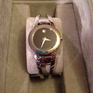 Movado Silver Movado cuff womans watch. Well kept.