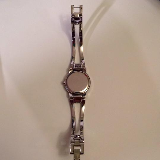 Movado Silver Movado cuff womans watch. Well kept. Image 5
