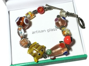Dazzling Designs Hand made/blown artisan glass animal and bead theme multi color bracelet with antique silver hardware