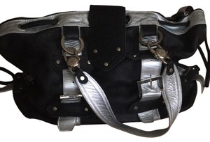 Gustto Leather Bag - celebrity loved designer bag Satchel in Black, Silver Exterior. Purple Lining
