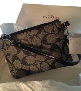 Coach Brand New Never Used Wristlet in Black