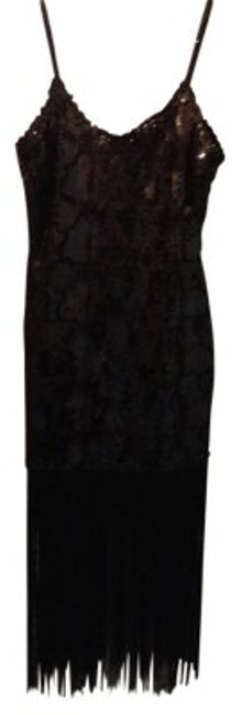 Preload https://item3.tradesy.com/images/black-sequin-knee-length-night-out-dress-size-12-l-11417-0-0.jpg?width=400&height=650