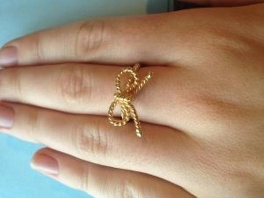 Chloe and Theodora love knot ring