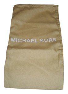 Michael Kors New Michael Kors Sleeper/ dust bag / Protective Cover 7 width x 13 Length Yellowish gold cotton with White Logo Drawstring bag.