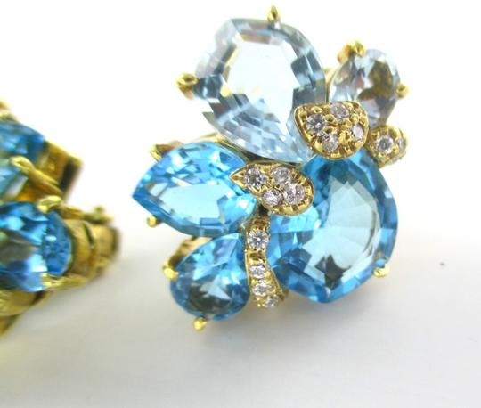 wendee & rene's 18KT YELLOW GOLD EARRINGS WITH 32 DIAMONDS & STUNNING BLUE TOPAZ