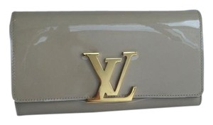 Louis Vuitton Wristlet in Light Tan