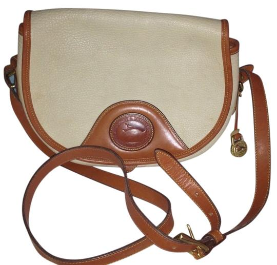 Preload https://item4.tradesy.com/images/dooney-and-bourke-vintage-colored-leather-cream-and-tan-shoulder-bag-1150468-0-0.jpg?width=440&height=440