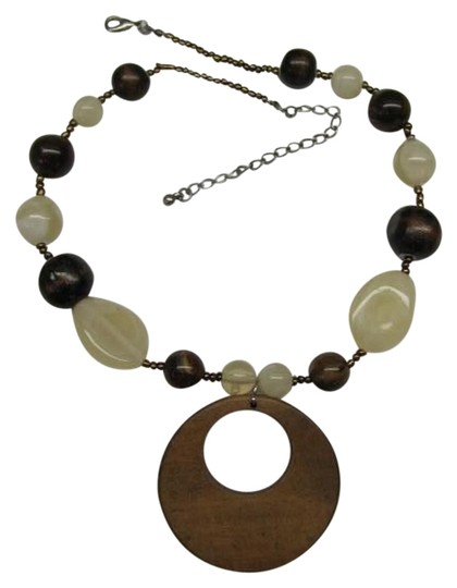 Preload https://item4.tradesy.com/images/brown-beige-round-wooden-pendant-necklace-1153563-0-0.jpg?width=440&height=440